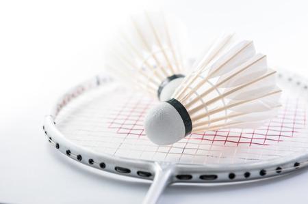 Shuttlecock on badminton racket closeup