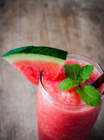 sliced watermelon: drink of watermelon smoothie on wooden Stock Photo