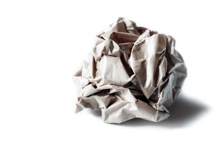 wastrel: Crumpled brown paper ball isolated on white