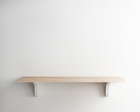 comfortable home: wood shelf on white wall background Stock Photo