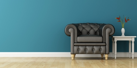 home decorations: black armchair and wall decorated of interior design Stock Photo