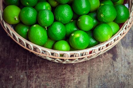 basket: Green lemon in rattan basket