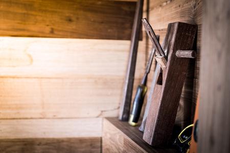 wood planer: closeup of planer tool on wood shelf