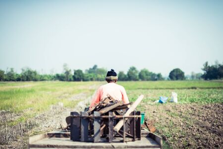career life: farmer driving tractor in a farm, career life of Thailand