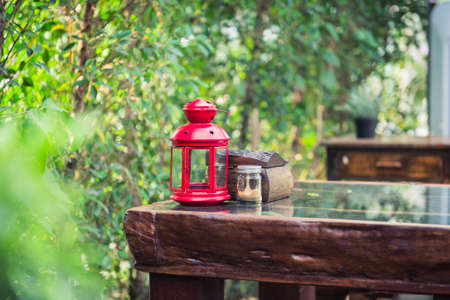 red lantern: closeup of red lantern on wood table Stock Photo