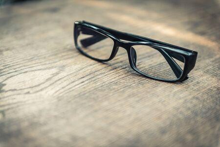 closeup of eye glasses on wooden floor Stock Photo