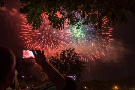 Traveler take a photo of firework festival Imagens