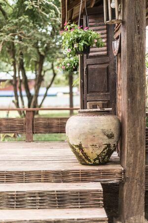 Closeup of old water jar on terrace