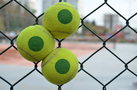 grating: tennis ball in a tennis corts grating