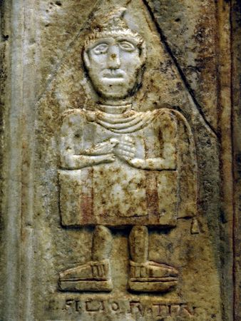 social history: Ancient bas-relief of the person with a birdy