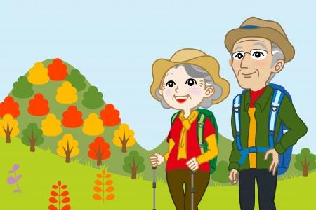 年配のカップルに秋の山に登る