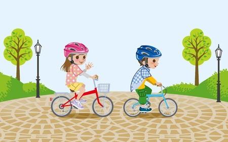 paving: Kids riding bicycle in the park,wore Helmet