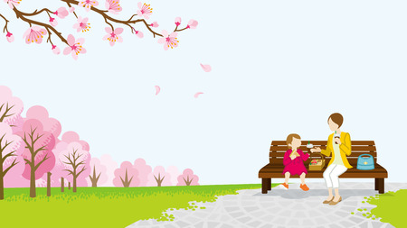 recreational pursuit: Mom and daughter picnic among the cherry trees