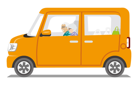 senior couple: Senior Couple riding the Orange color car, Side view-Isolated