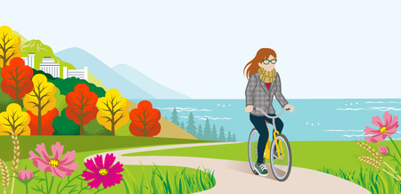Female Cyclist in Autumn nature