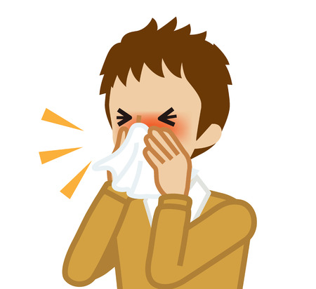Male student blowing nose with a tissue