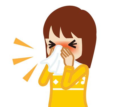 Niña niño soplando la nariz con un pañuelo