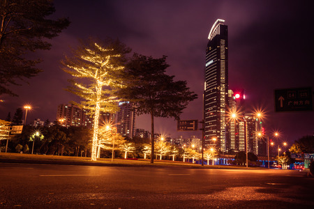 interesting building in shenzhen at night with city lights