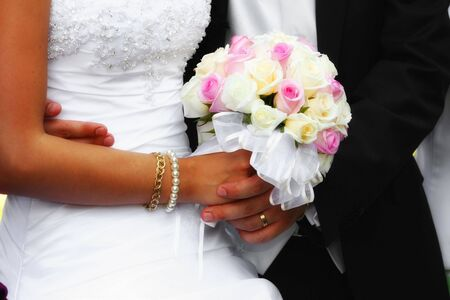 Wedding couple holding the bouquet Stock Photo - 5915569