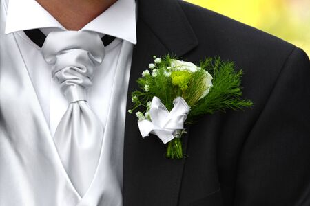 Wedding Boutonniere On Suit Jacket of Groom photo