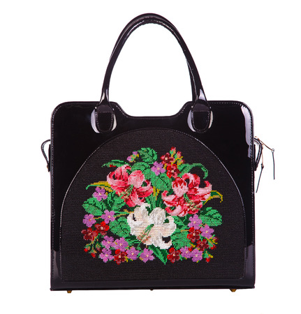 designer bag: Black designer bag with embroidered flowers isolated on white background