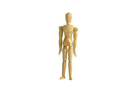 Wooden doll in a standing position on a white background. Stock Photo