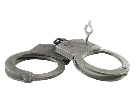 Handcuffs of the policeman on a white background