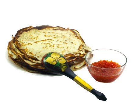 Russian pancakes with red caviar on a white background photo