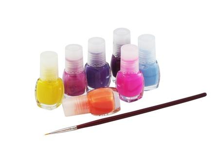 Nail polish and brush on a white background photo