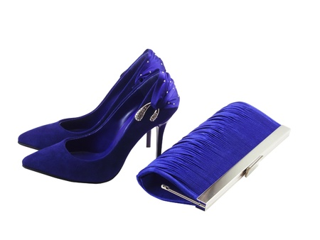 Dark blue female shoes on a high heel and clutch bag on a white background photo