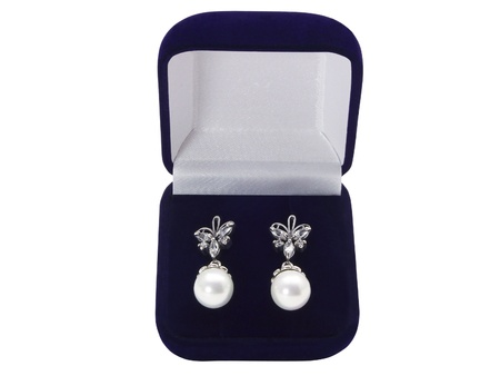 Earrings in a gift box on a white background photo