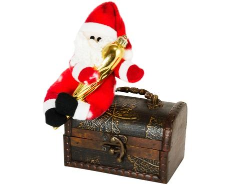 klaus: santa klaus sitting on an antiquarian chest on a white background