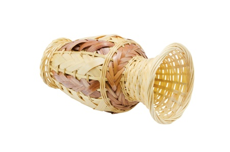 basket weaving: Handwork vase made by a basket  weaving method on a white background