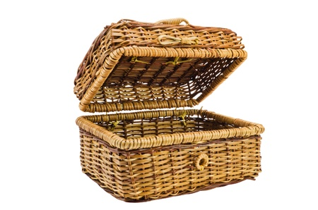 Wicker  basket with a cover on a white background photo