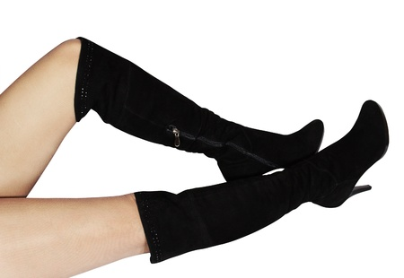 Female high boots of black colour on a high heel on beautiful feet Stock Photo - 14208889