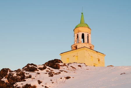 Watchtower on a grief  Lisya located in a city Nizhniy Tagil, in Russia,  in beams of the winter morning sun Stock Photo - 16843073