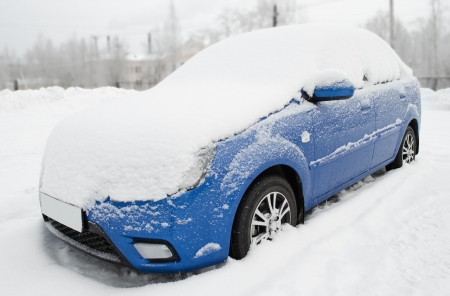means of transport: The car under snow on parking, after a snowfall