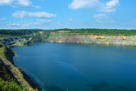 The thrown, flooded open-cast mine, Sverdlovsk area, Russia photo
