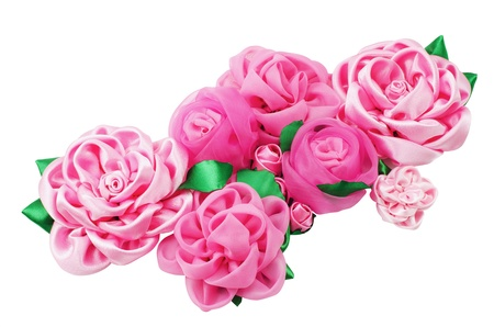 kanzashi: A lot of different beautiful artificial flowers of handwork isolated on a white background
