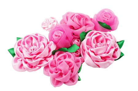 handwork: A lot of different beautiful artificial flowers of handwork isolated on a white background