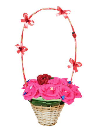 Beautifully decorated wicker  basket with artificial flowers, it is isolated on a white background photo