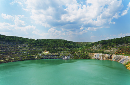 made in russia: The flooded open-cast mine where extraction of nickel ore earlier was made. Russia