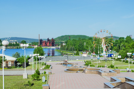 hark: NIZHNY TAGIL, RUSSIA - JUNE 01, 2014: The plant - Museum, ski jump complex, city park - main sights of the city of Nizhny Tagil on one photo.