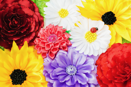 kanzashi: Multicolored background made of artificial flowers handmade
