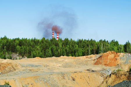 soil pollution: Environmental pollution.Lifeless, poisoned soil, remnants of a forest, and poisonous smoke from the factory chimneys