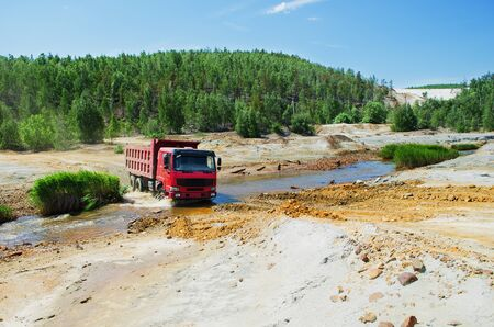polluted river: KARABASH, RUSSIA - JUNE 14, 2015: Truck, moving in the environs of the town Karabash, crossing the polluted river Editorial