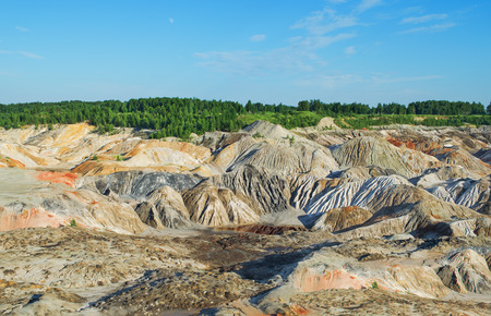 Unusual, unrealistic view of the earths surface,  incurred as a result of human activity. Abandoned deposits of refractory clays