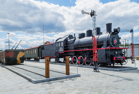 famous industries: VERKHNYAYA PYSHMA, RUSSIA - JUNE 11, 2015: Train with steam locomotive series EHm - exhibits of the Museum of military equipment. Editorial