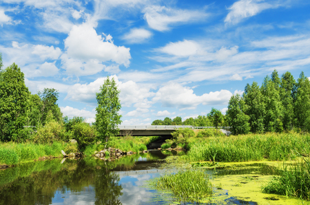 unusually: Beautiful landscape, unusually combining a road bridge across the river, and the beauty of nature Stock Photo