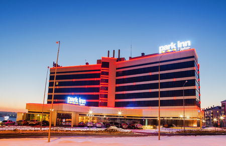 architectural lighting design: NIZHNY TAGIL, RUSSIA - FEBRUARY 13, 2016: The hotel Park inn with evening lights at sunset in winter Editorial